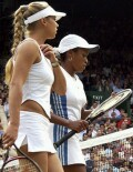 Anna and Chanda just before the start of their match vs Serena and Venus Williams on Saturday, July 6, 2002