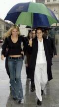 Anna and Conchita Martinez in the rain in Spain on Sunday Dec. 1, 2002-- click for Kournikova news photo search.