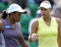 Anna and Chanda during their doubles match against Janet Lee and Wynne Prakusya on Monday, June 17, 2002. Click for current Anna news photo search.