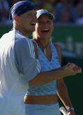 Anna and Alex vs Lucas Arnold and Patrica Tarabini of Argentina on January 18, 2003 in Melbourne