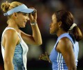 Anna and Chanda Rubin plot strategy during their match against Alexandra Stevenson of the US and Vanessa Webb of Canada on Thursday, Jan. 16, 2003, in Melbourne.